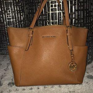 Beautiful brown leather Michael Kors zip purse.